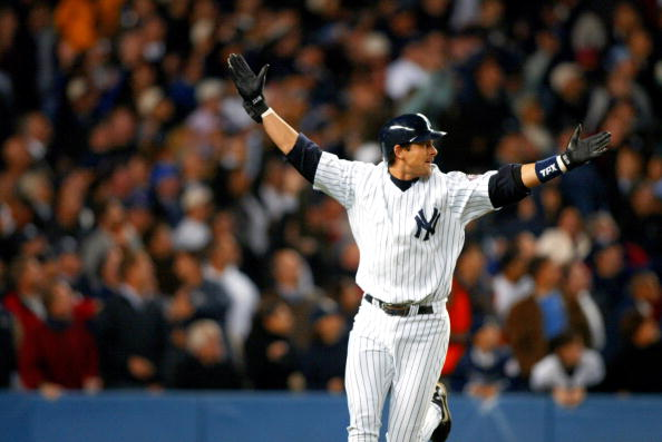 New York Yankees Aaron Boone celebrating his game winning home run against the Boston Red Sox at Yankee Stadium in New York City, New York.  The Yankees defeated the Red Sox in Game 7 of the 2003 ALCS 6 to 5.  The Yankees won the 2003 ALCS against the Red Sox 4 games to 3. (Photo by Allen Kee/WireImage)