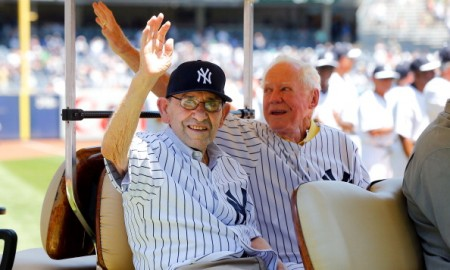 NEW YORK, NY - JUNE 23:  (NEW YORK DAILIES OUT)   Former New York Yankees and baseball Hall of Famers Yogi Berra (L) and Whitey Ford are introduced during the teams 67th Old Timers Day prior to a game against the Tampa Bay Rays at Yankee Stadium on SeptemberJune 23, 2013 in the Bronx borough of New York City. The Rays defeated the Yankees 3-1.  (Photo by Jim McIsaac/Getty Images)