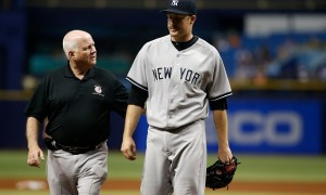 ST. PETERSBURG, FL - MAY 14:  Pitcher Chase Whitley #39 of the New York Yankees leaves the game with head athletic trainer Steve Donohue during the second inning of a game against the Tampa Bay Rays on May 14, 2015 at Tropicana Field in St. Petersburg, Florida.  (Photo by Brian Blanco/Getty Images)