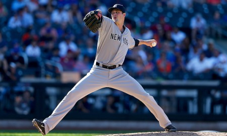 NEW YORK, NY - SEPTEMBER 19:  Andrew Miller #48 of the New York Yankees delivers a pitch in the ninth inning against the New York Mets during interleague play on September 19, 2015 at Citi Field in the Flushing neighborhood of the Queens borough of New York City.The New York Yankees defeated the New York Mets 5-0.  (Photo by Elsa/Getty Images)