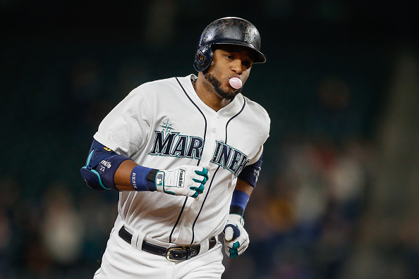 SEATTLE, WA - SEPTEMBER 29:  Robinson Cano #22 of the Seattle Mariners rounds the bases after hitting a two-run home run against the Houston Astros in the sixth inning at Safeco Field on September 29, 2015 in Seattle, Washington.  (Photo by Otto Greule Jr/Getty Images)