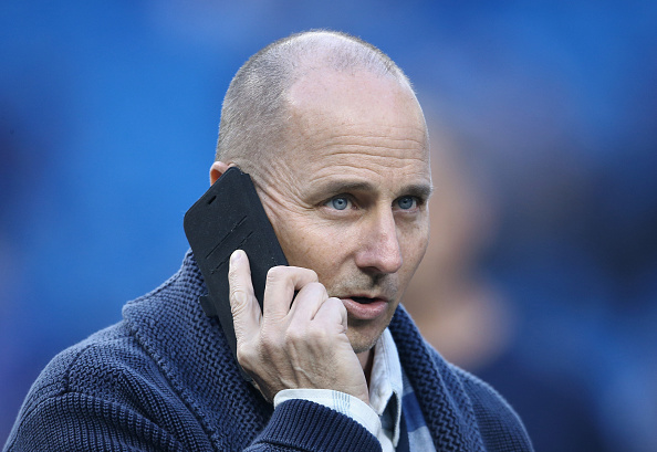 TORONTO, CANADA - SEPTEMBER 21: General manager Brian Cashman of the New York Yankees talks on the phone during batting practice before the start of MLB game action against the Toronto Blue Jays on September 21, 2015 at Rogers Centre in Toronto, Ontario, Canada. (Photo by Tom Szczerbowski/Getty Images)