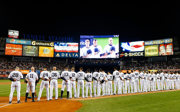 NEW YORK, NY - OCTOBER 06:  (NEW YORK DAILIES OUT)   The New York Yankees and the Houston Astros stand for the national anthem before the American League Wild Card Game at Yankee Stadium on October 6, 2015 in the Bronx borough of New York City, New York. The Astros defeated the Yankees 3-0.  (Photo by Jim McIsaac/Getty Images)
