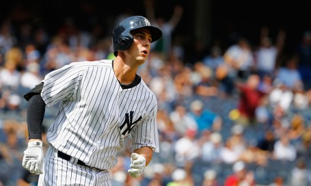 NEW YORK, NY - AUGUST 19:  Greg Bird #31 of the New York Yankees hits a two run home run against the Minnesota Twins in the fourth inning during their game at Yankee Stadium on August 19, 2015 in New York City.  (Photo by Al Bello/Getty Images)