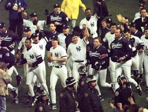 NEW YORK, UNITED STATES:  The New York Yankees celebrate 26 October after beating the Atlanta Braves in game six 3-2 to win the World Series at Yankee Stadium in New York.    (ELECTRONIC IMAGE) AFP PHOTO/Timothy CLARY (Photo credit should read TIMOTHY A. CLARY/AFP/Getty Images)