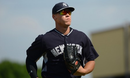 LAKELAND, FL - MARCH 20:  Aaron Judge #99 of the New York Yankees looks on during the Spring Training game against the Detroit Tigers at Joker Marchant Stadium on March 20, 2015 in Lakeland, Florida. The Yankees defeated the Tigers 11-2.  (Photo by Mark Cunningham/MLB Photos via Getty Images)