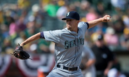 OAKLAND, CA - APRIL 11:  Tyler Olson #66 of the Seattle Mariners pitches against the Oakland Athletics during the tenth inning at O.co Coliseum on April 11, 2015 in Oakland, California. The Seattle Mariners defeated the Oakland Athletics 5-4 in 11 innings. (Photo by Jason O. Watson/Getty Images)
