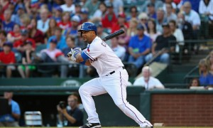 ARLINGTON, TX - APRIL 29:  Carlos Corporan #3 of the Texas Rangers hits a rbi single against the Seattle Mariners in the second inning at Globe Life Park in Arlington on April 29, 2015 in Arlington, Texas.  (Photo by Ronald Martinez/Getty Images)