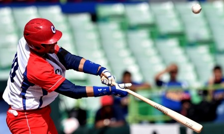 Cuban National baseball infielder Yulieski Gurriel hits the ball in the 5th inning against the Venezuela National baseball team during the Serie Del Caribe February 5, 2015 in San Juan, Puerto Rico.  AFP PHOTO/PAUL  J. RICHARDS        (Photo credit should read PAUL J. RICHARDS/AFP/Getty Images)