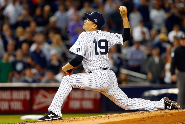 NEW YORK, NY - OCTOBER 06:  (NEW YORK DAILIES OUT)   Masahiro Tanaka #19 of the New York Yankees in action against the Houston Astros during the American League Wild Card Game at Yankee Stadium on October 6, 2015 in the Bronx borough of New York City, New York. The Astros defeated the Yankees 3-0.  (Photo by Jim McIsaac/Getty Images)