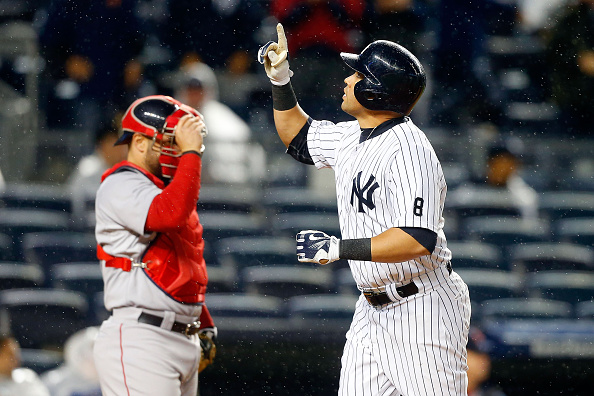 NEW YORK, NY - OCTOBER 01:  (NEW YORK DAILIES OUT)    Carlos Beltran #36 of the New York Yankees in action against the Boston Red Sox at Yankee Stadium on October 1, 2015 in the Bronx borough of New York City. The Yankees defeated the Red Sox 4-1. The Yankees clinched a wildcard playoff position and won their 10,000th regular season game.  (Photo by Jim McIsaac/Getty Images)