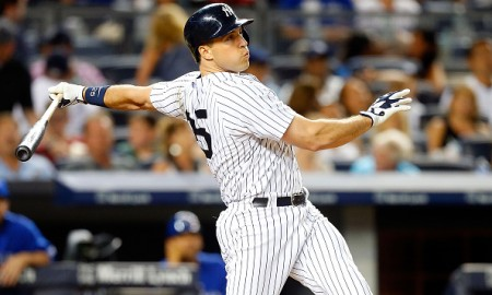 NEW YORK, NY - AUGUST 07:  Mark Teixeira #25 of the New York Yankees in action against the Toronto Blue Jays at Yankee Stadium on August 7, 2015 in the Bronx borough of New York City. The Blue Jays defeated the Yankees 2-1 after ten innings.  (Photo by Jim McIsaac/Getty Images)