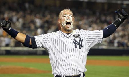 NEW YORK - JULY 16:  Nick Swisher #33 of the New York Yankees celebrates his game winning RBI base hit in the ninth inning against the Tampa Bay Rays on July 16, 2010 at Yankee Stadium in the Bronx borough of New York City. The Yankees defeated the Rays 5-4.  (Photo by Jim McIsaac/Getty Images)