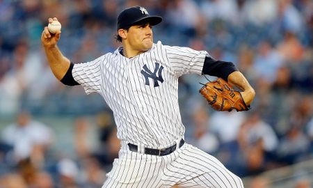NEW YORK, NY - AUGUST 24:  Nathan Eovaldi #30 of the New York Yankees in action against the Houston Astros at Yankee Stadium on August 24, 2015 in the Bronx borough of New York City. The Yankees defeated the Astros 1-0.  (Photo by Jim McIsaac/Getty Images)