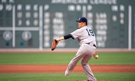 BOSTON, MA - SEPTEMBER 2: Masahiro Tanaka #19 of the New York Yankees pitches against the Boston Red Sox during the seventh inning at Fenway Park on September 2, 2015 in Boston, Massachusetts. (Photo by Michael Ivins/Boston Red Sox/Getty Images)