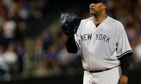 NEW YORK, NY - SEPTEMBER 20: CC Sabathia #52 of the New York Yankees pitches against the New York Mets at Citi Field on September 20, 2015 in the Queens borough of New York City. (Photo by Adam Hunger/Getty Images)