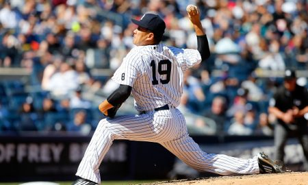 NEW YORK, NY - APRIL 17:  Masahiro Tanaka #19 of the New York Yankees in action against the Seattle Mariners at Yankee Stadium on April 17, 2016 in the Bronx borough of New York City. The Yankees defeated the Mariners 4-3.  (Photo by Jim McIsaac/Getty Images)