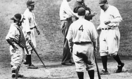 NEW YORK - 1934.  Babe Ruth, New York Yankees outfielder, is greeted at home plate by Lou Gehrig, number 4, and Yankee batboy, second from left, while Washington Senators catcher Luke Sewell looks on.  (Photo by Mark Rucker/Transcendental Graphics, Getty Images)