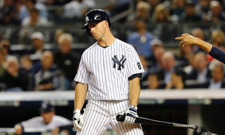 NEW YORK, NY - OCTOBER 06:  Brett Gardner #11 of the New York Yankees reacts after a pitch in the eighth inning against the Houston Astros during the American League Wild Card Game at Yankee Stadium on October 6, 2015 in New York City.  (Photo by Elsa/Getty Images)
