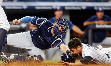 NEW YORK, NY - APRIL 22:  Curt Casali #19 of the Tampa Bay Rays is late with the tag as Jacoby Ellsbury #22 of the New York Yankees steals home during the fifth inning at Yankee Stadium on April 22, 2016 in the Bronx borough of New York City.  (Photo by Jim McIsaac/Getty Images)