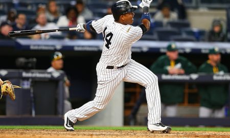NEW YORK, NY - APRIL 19: Starlin Castro #14 of the New York Yankees doubles to left in the fifth inning against the Oakland Athletics at Yankee Stadium on April 19, 2016 in the Bronx borough of New York City.  (Photo by Mike Stobe/Getty Images)