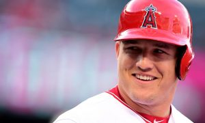 ANAHEIM, CA - MAY 07:  Mike Trout #27 of the Los Angeles Angels smiles on base against the Tampa Bay Rays at Angel Stadium of Anaheim on May 07, 2016 in Anaheim, California.  (Photo by Harry How/Getty Images)