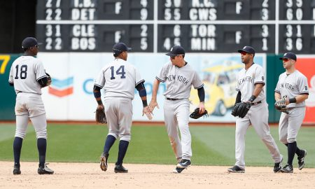 OAKLAND, CA - MAY 22: Members of the New York Yankees congratulate each other in the infield after defeating the Oakland Athletics 5-4 at O.co Coliseum on May 22, 2016 in Oakland, California. (Photo by Stephen Lam/Getty Images)