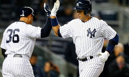 NEW YORK, NY - APRIL 09:  Alex Rodriguez #13 of the New York Yankees celebrates his sixth inning home run against the Toronto Blue Jays with teammate Carlos Beltran #36 at Yankee Stadium on April 9, 2015 in the Bronx borough of New York City.  (Photo by Jim McIsaac/Getty Images)