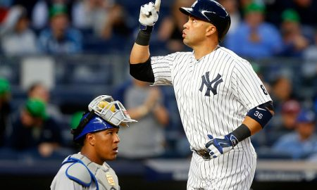 NEW YORK, NY - MAY 09:  Carlos Beltran #36 of the New York Yankees celebrates his third inning home run as Salvador Perez #13 of the Kansas City Royals looks on at Yankee Stadium on May 9, 2016 in the Bronx borough of New York City.  (Photo by Jim McIsaac/Getty Images)