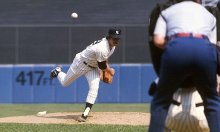NEW YORK - CIRCA 1978: Jim Catfish Hunter #27 of the New York Yankees pitches during an Major League Baseball game circa 1978 at Yankee Stadium in the Bronx borough of New York City. Hunter  played for the Yankees from 1974-79. (Photo by Focus on Sport/Getty Images)