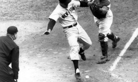 "BROOKLYN, NY - SEPTEMBER 30:  Catcher Roy Campanella #39 of the Brooklyn Dodgers can't handle the ball as Bill ""Moose"" Skowron #14 of the New York Yankees scores during Game 3 of the 1955 World Series on September 30, 1955 at Ebbets Field in Brooklyn, New York.  (Photo by B Bennett/Getty Images)"