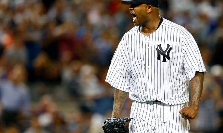 NEW YORK, NY - AUGUST 6: Pitcher CC Sabathia #52 of the New York Yankees reacts after striking out David Ortiz #34 of the Boston Red Sox to end the fifth inning during a MLB baseball game at Yankee Stadium on August 6, 2015 in the Bronx borough of New York City. (Photo by Rich Schultz/Getty Images)