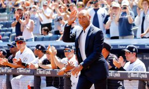 NEW YORK, NY - AUGUST 22:  Former New York Yankee Derek Jeter is introduced during a ceremony for former teammate Jorge Posada prior to a game between the Yankees and the Cleveland Indians at Yankee Stadium on August 22, 2015 in the Bronx borough of New York City.  (Photo by Jim McIsaac/Getty Images)