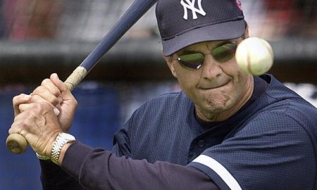 WINTER HAVEN, UNITED STATES:  New York Yankees' manager Joe Torre hits grounders before the start of the spring training game with the Cleveland Indians at Chain O'Lakes Stadium in Winter Haven, Florida 26 March 2001. AFP PHOTO/Tony RANZE (Photo credit should read TONY RANZE/AFP/Getty Images)