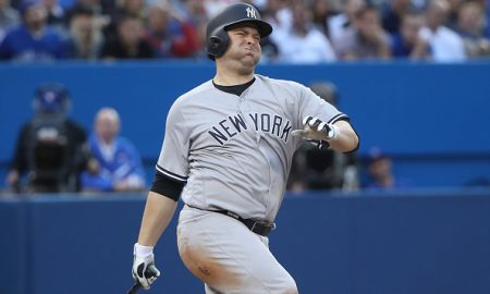TORONTO, CANADA - JUNE 1: Brian McCann #34 of the New York Yankees reacts after fouling a ball off his foot in the third inning during MLB game action against the Toronto Blue Jays on June 1, 2016 at Rogers Centre in Toronto, Ontario, Canada. (Photo by Tom Szczerbowski/Getty Images)
