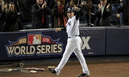 NEW YORK - NOVEMBER 04:  Mark Teixeira #25 of the New York Yankees points towards teammate Hideki Matsui after Matsui drove him in on a 2-run double in the bottom of the fifth inning against the Philadelphia Phillies in Game Six of the 2009 MLB World Series at Yankee Stadium on November 4, 2009 in the Bronx borough of New York City.  (Photo by Jim McIsaac/Getty Images)