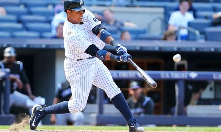 NEW YORK, NY - JUNE 22:  Starlin Castro #14 of the New York Yankees connects on a game winning solo home run in the bottom of the ninth-inning to defet the Colorado Rockies 9-7 at Yankee Stadium on June 22, 2016 in the Bronx borough of New York City.  (Photo by Mike Stobe/Getty Images)