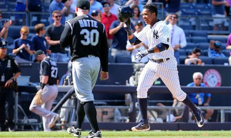 NEW YORK, NY - JUNE 22:  Starlin Castro #14 of the New York Yankees celebrates after hitting a game winning solo home run in the bottom of the ninth-inning as Jason Motte #30 of the Colorado Rockies walks off the field at Yankee Stadium on June 22, 2016 in the Bronx borough of New York City.  (Photo by Mike Stobe/Getty Images)