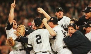 NEW YORK, UNITED STATES:  Members of the New York Yankees celebrate on the pitchers mound after beating the Atlanta Braves to win the World Series at Yankee Stadium in New York 26 October. The Yankees won the game 3-2 to claim the series four games to two. AFP PHOTO/Henny Ray ABRAMS (Photo credit should read HENNY RAY ABRAMS/AFP/Getty Images)