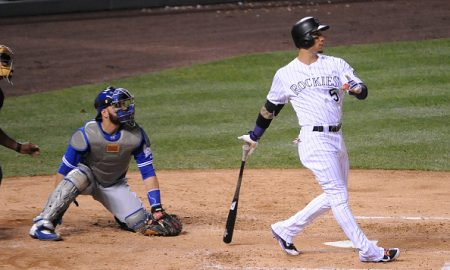 DENVER, CO - JUNE 28:  Carlos Gonzalez #5 of the Colorado Rockies hits a three run home run in the fourth inning against the Toronto Blue Jays at Coors Field on June 28, 2016 in Denver, Colorado.  The Toronto Blue Jays defeat the Colorado Rockies 14-9. (Photo by Bart Young/Getty Images)