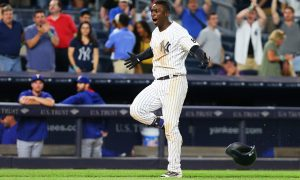 NEW YORK, NY - JUNE 29:  Didi Gregorius #18 of the New York Yankees celebrates after hitting a game winning two-run home run in the bottom of the ninth inning against the Texas Rangers at Yankee Stadium on June 29, 2016 in the Bronx borough of New York City. Yankees defeated the Rangers 9-7  (Photo by Mike Stobe/Getty Images)