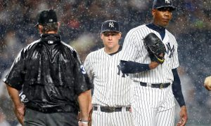 NEW YORK, NY - JUNE 27:  Aroldis Chapman #54 and Chase Headley #12 of the New York Yankees look on before a rain delay against the Texas Rangers at Yankee Stadium on June 27, 2016 in the Bronx borough of New York City. The Rangers defeated the Yankees 9-6.  (Photo by Jim McIsaac/Getty Images)