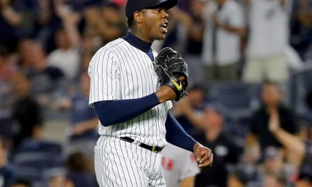 NEW YORK, NY - JULY 17:  Aroldis Chapman #54 of the New York Yankees celebrates the 3-1 win over the Boston Red Sox at Yankee Stadium on July 17, 2016 in the Bronx borough of New York City.  (Photo by Elsa/Getty Images)