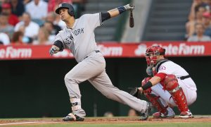 ANAHEIM, CALIFORNIA - AUGUST 20: Gary Sanchez #24 of the New York Yankees hits a solo home run in the first inning against the Los Angeles Angels of Anaheim at Angel Stadium of Anaheim on August 20, 2016 in Anaheim, California. (Photo by Stephen Dunn/Getty Images)