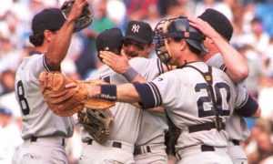 TORONTO, CANADA - OCTOBER 1:  Don Mattingly of the New York Yankees (C) hugs teammate Pat Kelly as outfielder Ruben Rivera (L) and catcher Mike Stanley (R) join the celebration after the Yankees clinched the American League wild card berth by beating the Toronto Blue Jays at Skydome 01 October. The Yankees beat the Blue Jays 6-1 and will make their first playoff appearance since 1981.   AFP PHOTO  (Photo credit should read GREIG REEKIE/AFP/Getty Images)
