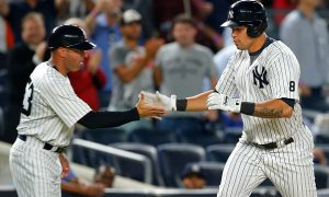NEW YORK, NY - SEPTEMBER 13: Gary Sanchez #24 of the New York Yankees is congratulated by third base coach Joe Espada #53 after hitting a home run against the Los Angeles Dodgers during the eighth inning of a game at Yankee Stadium on September 13, 2016 in New York City. The Yankees defeated the Dodgers 3-0. (Photo by Rich Schultz/Getty Images)