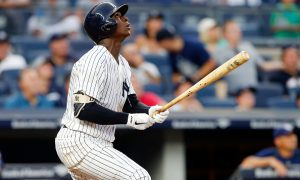 NEW YORK, NY - SEPTEMBER 10:  Didi Gregorius #18 of the New York Yankees follows through on an eighth inning run scoring sacrifice fly against the Tampa Bay Rays at Yankee Stadium on September 10, 2016 in the Bronx borough of New York City.  (Photo by Jim McIsaac/Getty Images)