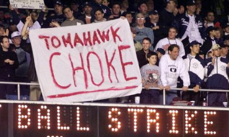"NEW YORK, UNITED STATES:  New York Yankees fans hang a banner making fun of the Atlanta Braves fans' ""tomahawk chop"" 26 October, 1999, during game 3 of the 1999 World Series against the Atlanta Braves at Yankee Stadium in New York, NY. The Yankees won 6-5 to take a 3-0 lead in the best-of-seven series.  (ELECTRONIC IMAGE)  AFP PHOTO/JEFF HAYNES (Photo credit should read JEFF HAYNES/AFP/Getty Images)"