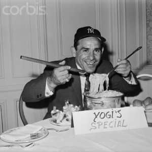 Yogi Berra Digging into Pot of Spaghetti